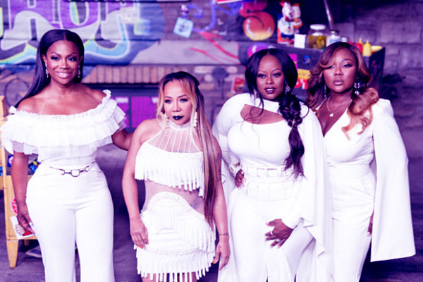 Image of Caption: Kandi Burruss and her band members of Xscape.