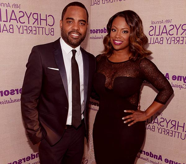 Image of Caption: Kandi Burruss alongside her husband, Todd Tucker.
