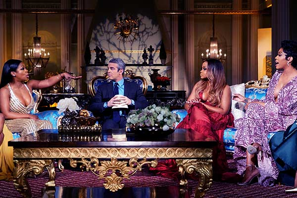 Image of Kandi Burruss, Andy Cohen, Phaedra Parks, & Porsha Williams during the reunion in Season 9