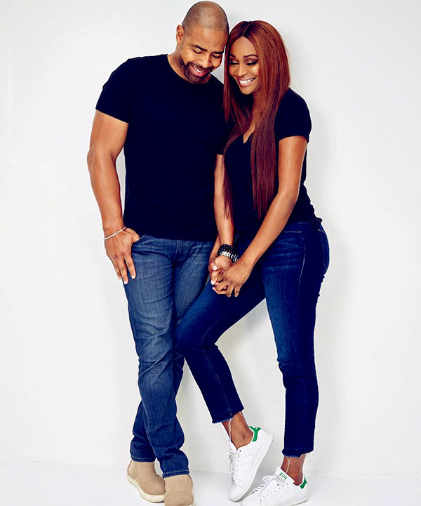 Image of Caption: Bailey and Mike hold hands in matching black t-shirt and jeans