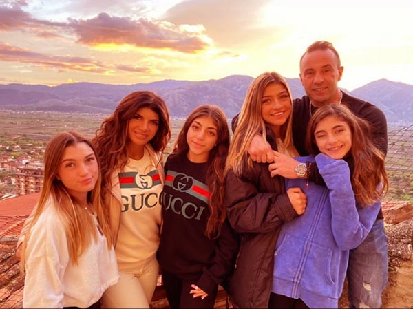 Image of Caption: Milania with her parents and sisters