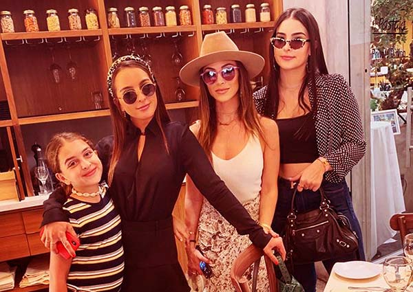 Image of Farrah with her three younger sisters that were born from her mother's second marriage